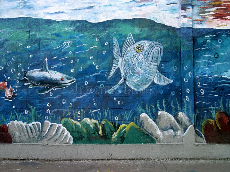 Urban ARt. Marine life. Photo of a mural painted on a wall . Barcelona , Venezuela , South America. It shows a shark and grouper fish in a marine environment stock photo