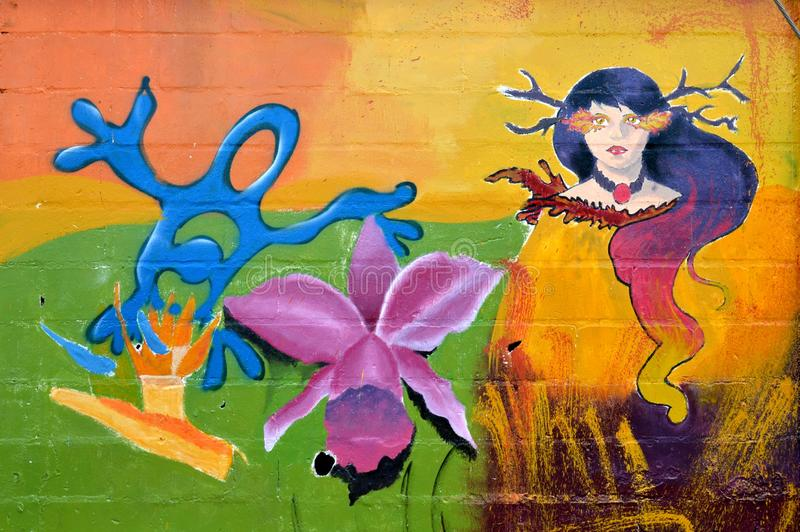 Urban art. orchid , frog and wife stock images