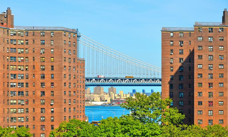 Urban back ground with old classic brick buildings and Manhattan bridge with traffic and Hudson river and clear blue sky in Manhat. Tan, New York skyline royalty free stock photos