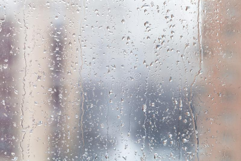 Rain drops on window glass in winter day royalty free stock photos