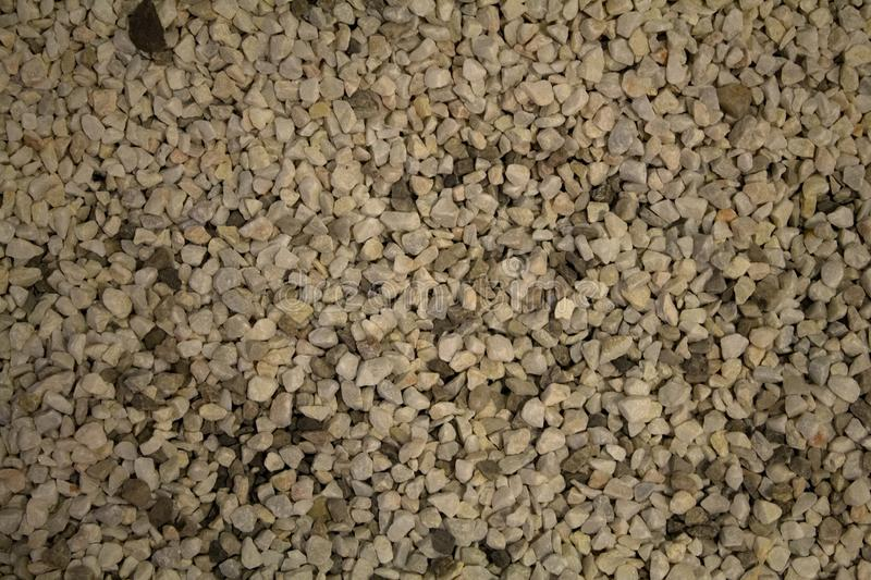Urban beige floor texture with pebbles. Background pattern. Architectural details stock photo
