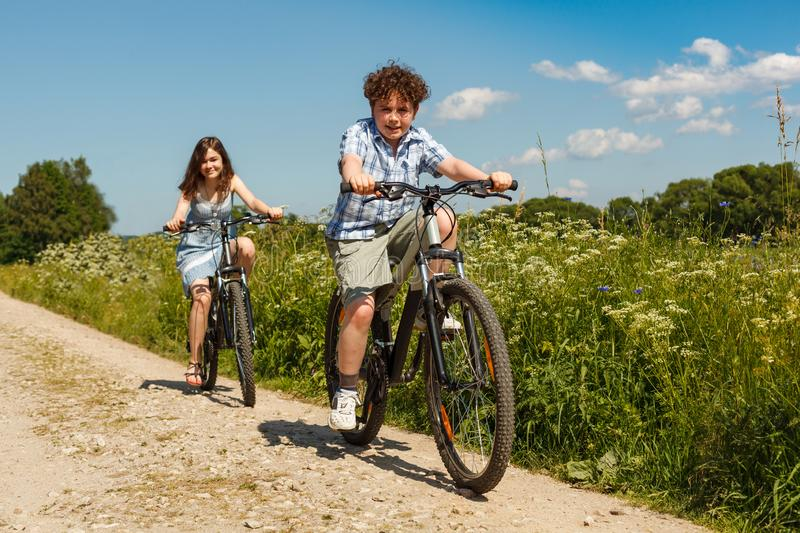 Urban biking - kids riding bikes. Outdoor stock photo