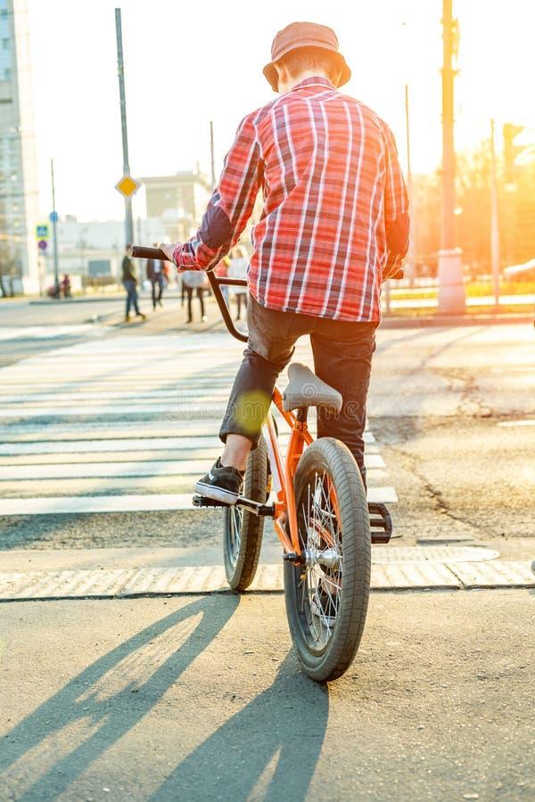 Urban biking - teenage boy riding bike in city stock images