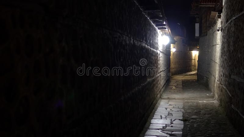 urban city stone pavement alley at night stock photography