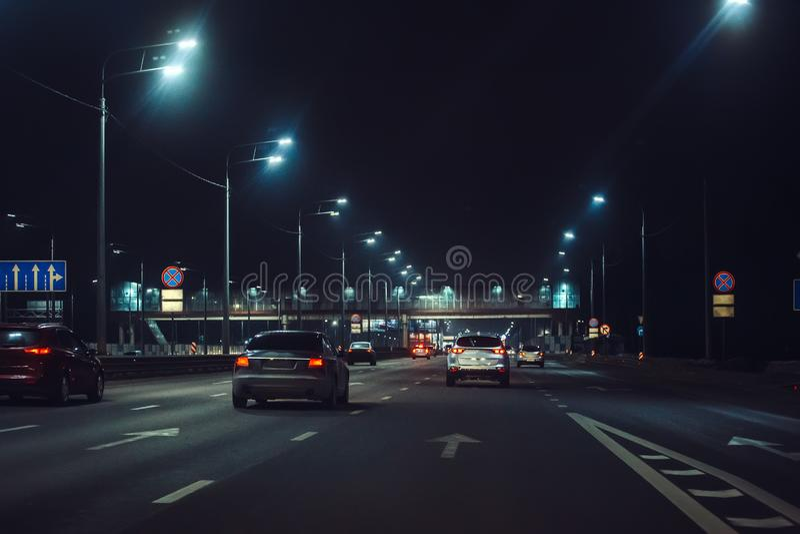 Urban city traffic cars in night illuminated asphalt city road, abstract cityscape transportation concept royalty free stock photography