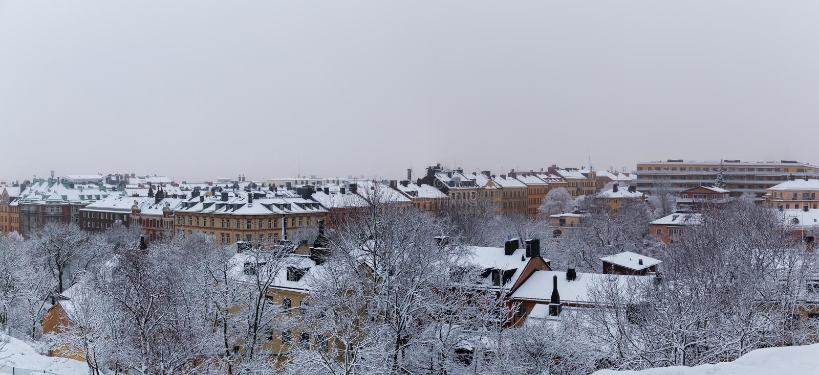 Urban city view of the old houses from a hill in Stockholm City, Sweden. Urban city view of the old houses from a hill in Stockholm City on a foggy winter day stock images