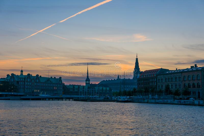 Urban cityscape of Copenhagen, silhouette of downtown at sunset royalty free stock photo