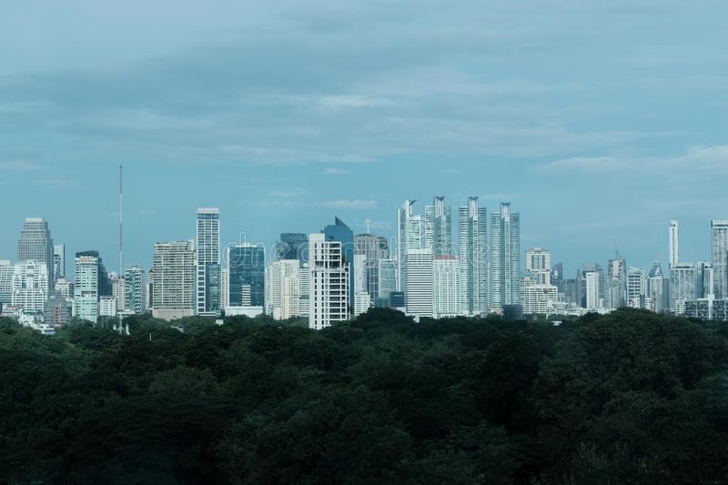 Urban cityscape and green forest in the city royalty free stock photo