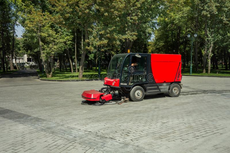Urban cleaning process. Special vehicle washes city street or park. Ecology and pure air in modern megalopolis concept. Technology. Of municipal services royalty free stock photography