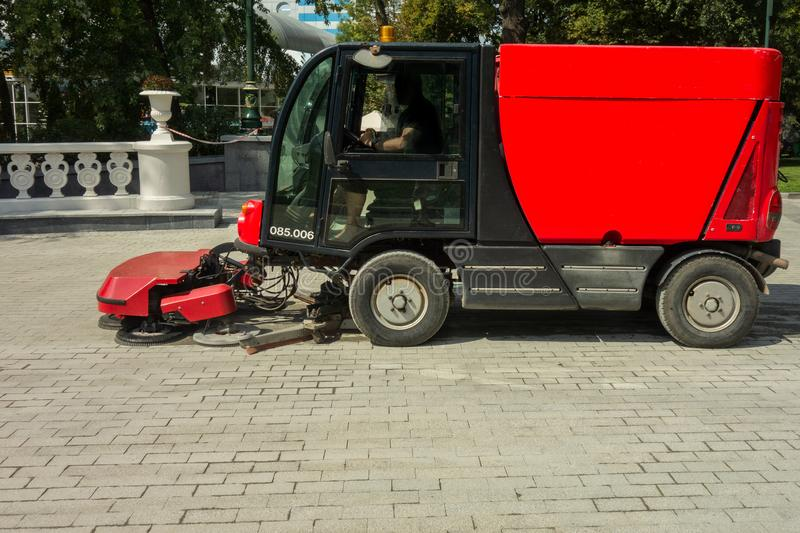 Urban cleaning process. Special vehicle washes city street or park. Ecology and pure air in modern megalopolis concept. Technology. Of municipal services royalty free stock photos