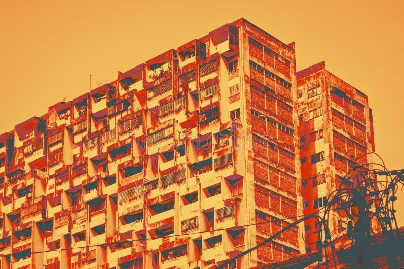 Urban decay old appatment block duo tone image. Orange royalty free stock image