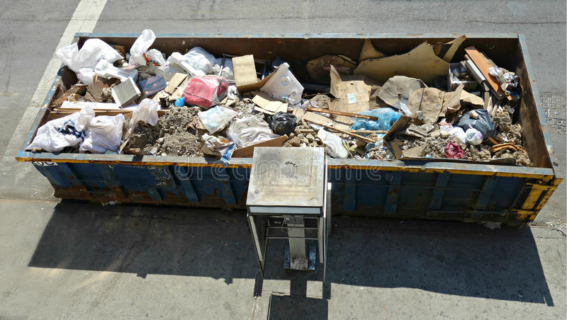 Urban Dumpster. A dumpster filled with trash, in New York royalty free stock photo