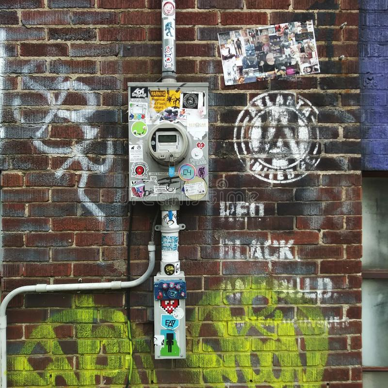 Urban Electricity Meter and Brick Wall. Urban Electricity Meter on Brick Wall, meters, measure, measuring, measurement, equipment, gauge, gauges, urbanscape royalty free stock photography