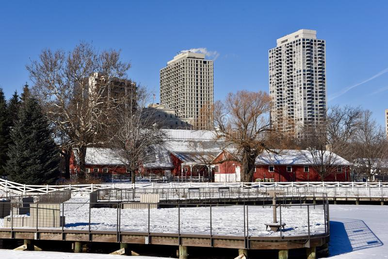 Urban Farm. This is a Winter picture of the urban farm at the Lincoln Park Zoo as seen from the board walk on the frozen South Pond located in Chicago, Illinois stock image