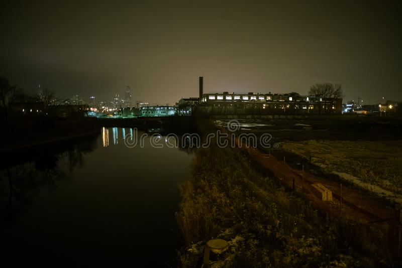 Urban fog river scenery in Chicago at night. stock images