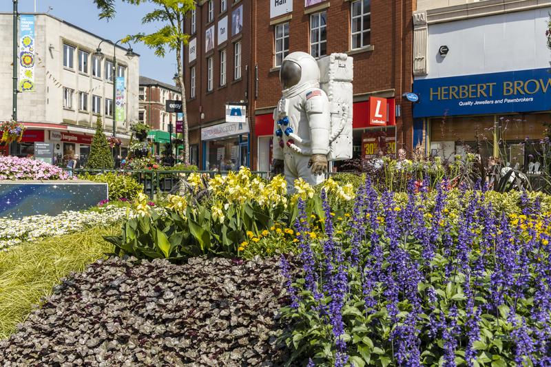 Urban garden design commemorating Landing on The Moon. OLDHAM, LANCASHIRE, UK - July 25, 2019: Alien landscape with American astronauts landing on the Moon royalty free stock photography