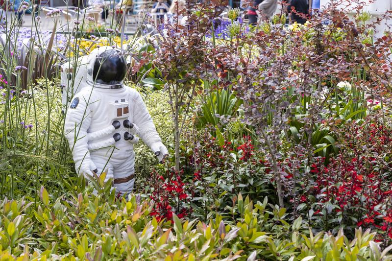 Urban garden design commemorating Landing on The Moon. OLDHAM, LANCASHIRE, UK - July 25, 2019: Alien landscape with American astronauts landing on the Moon stock images