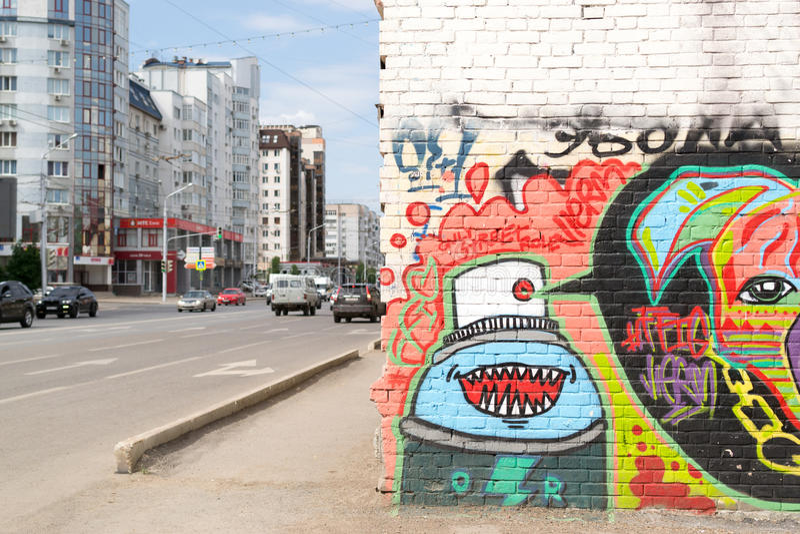 Urban Graffiti on a Wall with Traffic royalty free stock photo