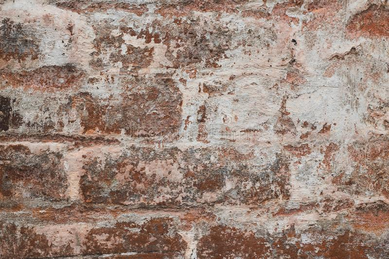 Urban grunge texture background. Abstract pattern on brown stucco backdrop. Cracked red old dilapidated wall, grunge textured. Vin stock images