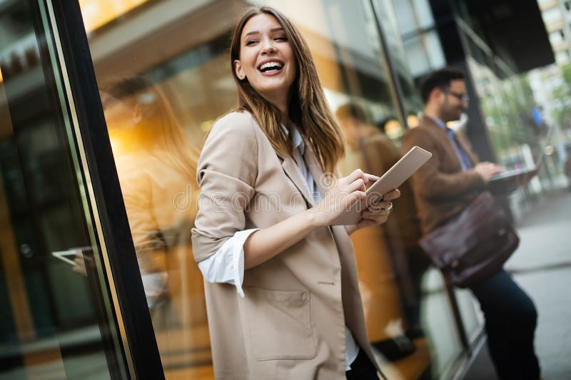 Urban happy business woman using tablet computer and working royalty free stock photos