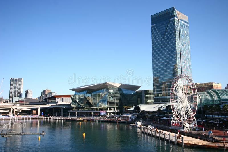 City waterfront with iconic cityscape of ICC Sydney, Sofitel, Harboourside Shopping Centre and white ferris wheel. Darling Harbour royalty free stock photography
