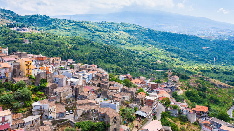 Urban houses of Castiglione di Sicilia town. Travel to Italy - above view of urban houses of Castiglione di Sicilia town and mountain valley in Sicily stock image