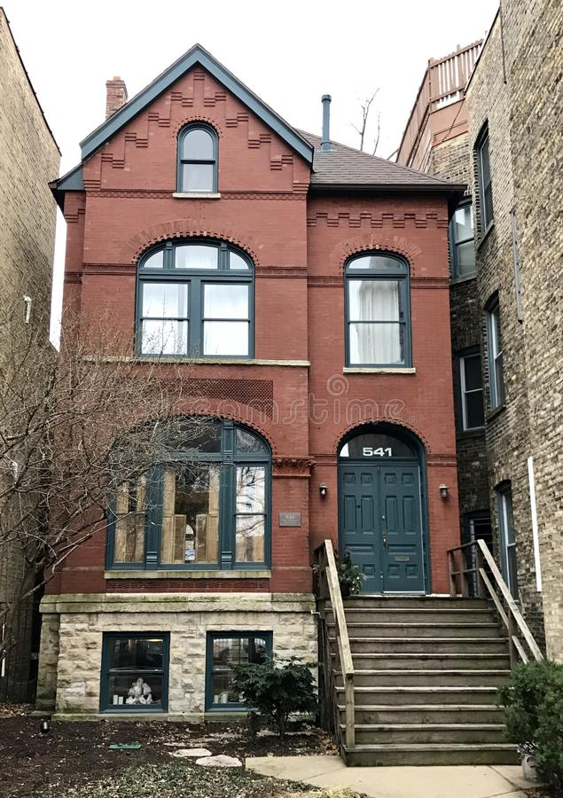Urban Italianate House. This is a Winter picture of a house on a foggy day in the East zlakeview neighborhood of Chicago, Illinois. This house built in 1890 is royalty free stock image