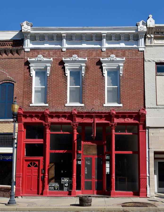 Urban Italianate In Mitchell. This is a Summer picture of a combination retail and residential building in Mitchell, Indiana in Lawrence County. This building is royalty free stock images