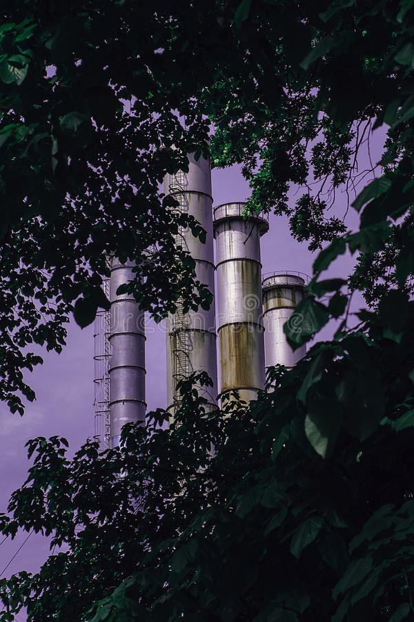 Urban jungle, nature and factory furnaces royalty free stock photography