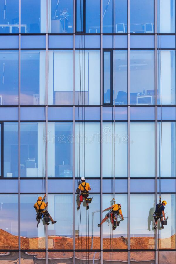 Free Urban Landscape - A Team Of Window Washers During Work At Height Royalty Free Stock Photos - 176809278