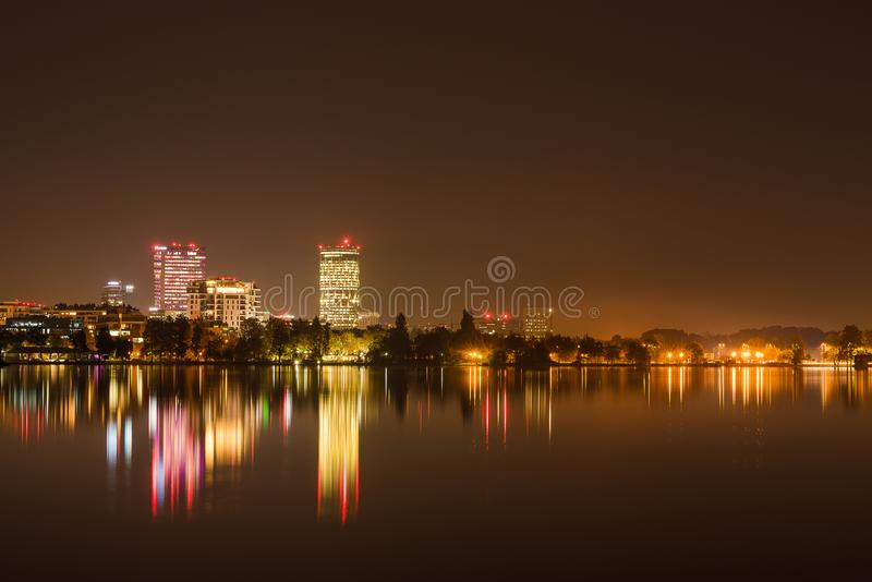 Bucharest night view from Herastrau park. Urban landscape in Bucharest, Herastrau park view in autumn season, beautiful buildings vibrant lighting reflections in stock photos