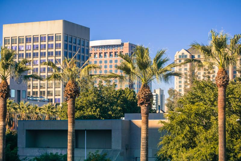 Urban landscape in downtown San Jose, California. Office buildings and palm trees in downtown San Jose at sunset, California stock images