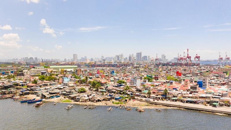 The urban landscape of Manila, with slums and skyscrapers. Sea port and residential areas. The contrast of poor and rich areas. The capital of the Philippines stock photography