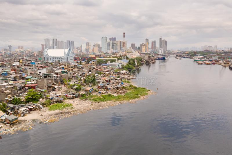 The urban landscape of Manila, with slums and skyscrapers. Sea port and residential areas. The contrast of poor and rich areas. The capital of the Philippines stock images