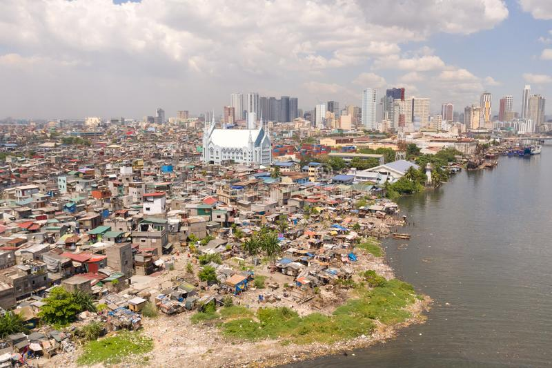 The urban landscape of Manila, with slums and skyscrapers. Sea port and residential areas. The contrast of poor and rich. Areas. The capital of the Philippines stock image