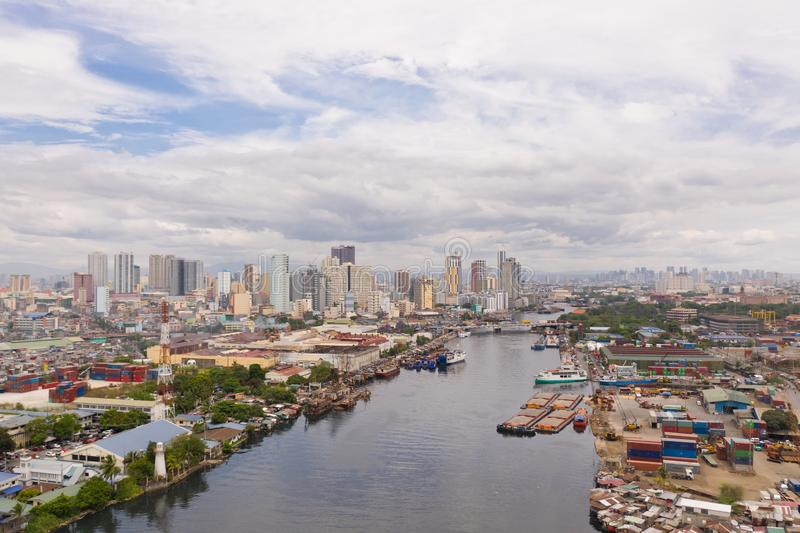 The urban landscape of Manila, with slums and skyscrapers. Sea port and residential areas. The contrast of poor and rich areas. The capital of the Philippines royalty free stock photos