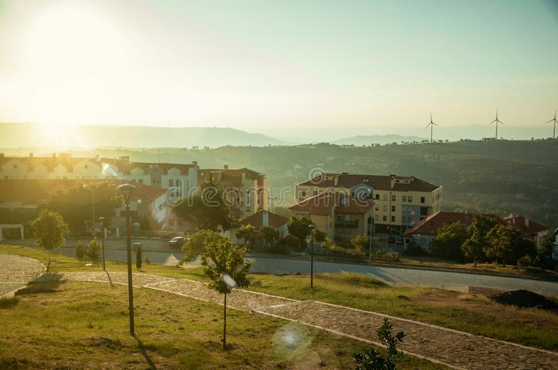 Modern apartment buildings in front of garden on sunset stock images