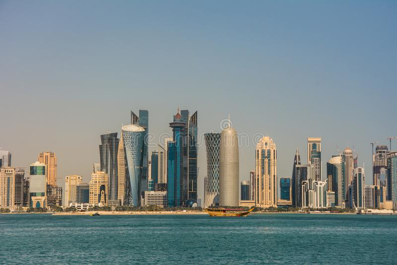 Urban landscape of modern Doha city skyline with skyscrapers. And waterfront royalty free stock photo