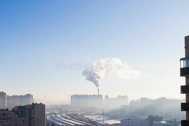 Urban landscape smoked polluted atmosphere from emissions of plants and factories, view of pipes with smoke and royalty free stock images