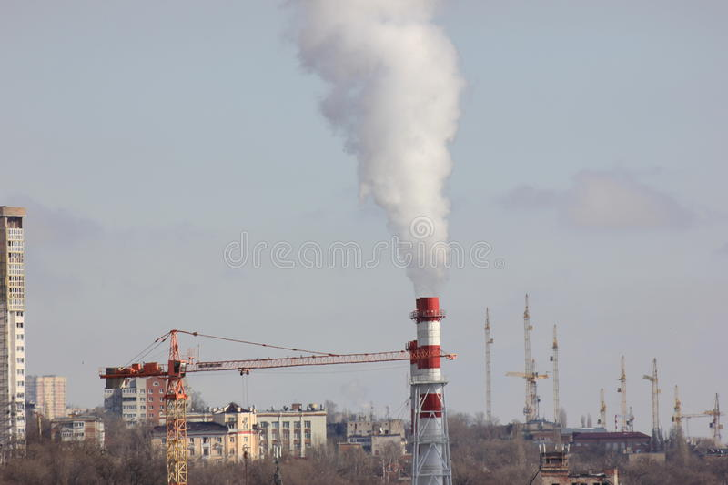 The urban landscape of Smoking factory pipes royalty free stock images