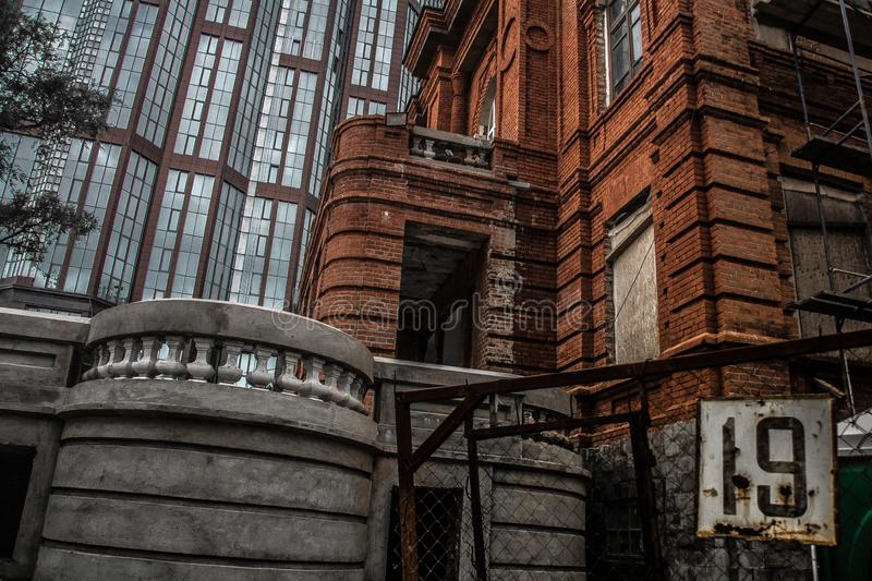 Urban landscape of the Vladivostok suburb. The outskirts of the city. Ruins and modernity. walking around town stock photos