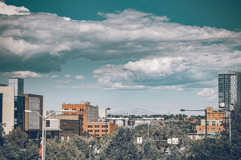 Urban lifestyle in the Denver city of Colorado state. Downtown district on a sunny day with beautiful sky. Amazing buildings in. The heart of Denver royalty free stock photography