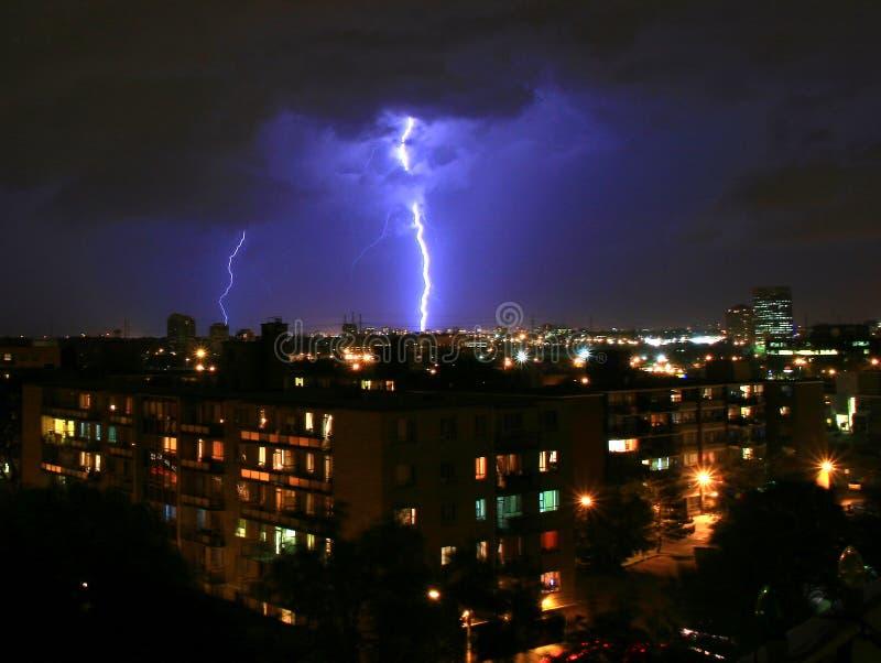 Urban lightning strike. Powerful lightning strikes the big city royalty free stock photos