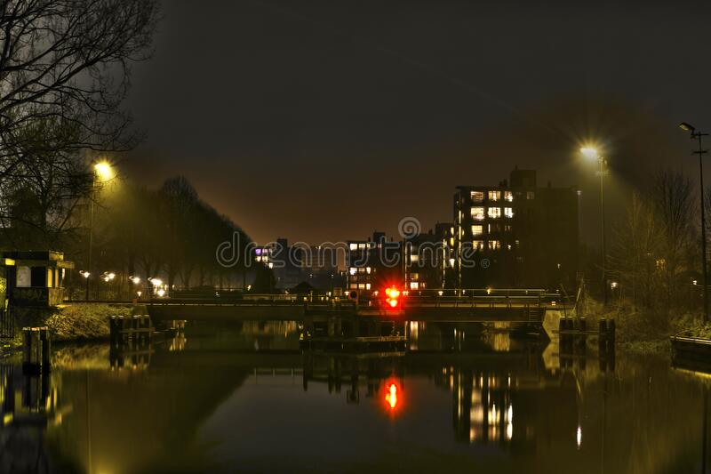 Urban lights reflecting in water royalty free stock photography