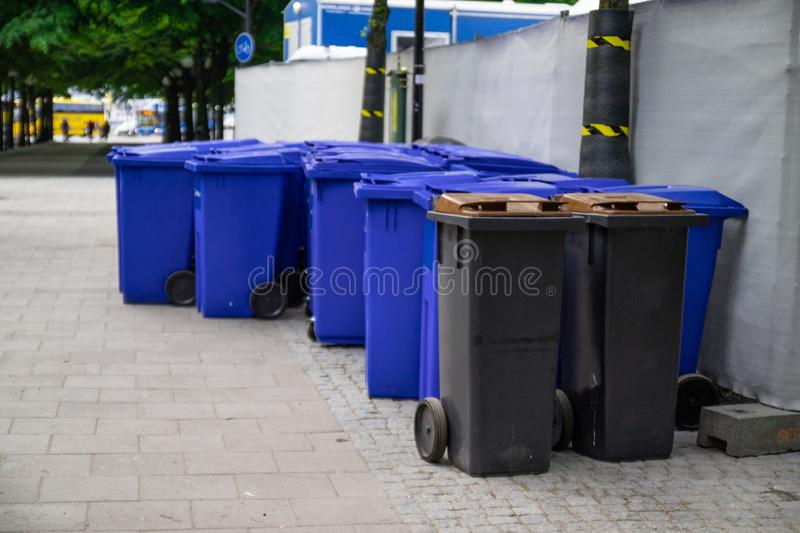 Urban litter bins. Black street bins for separate waste collection royalty free stock images