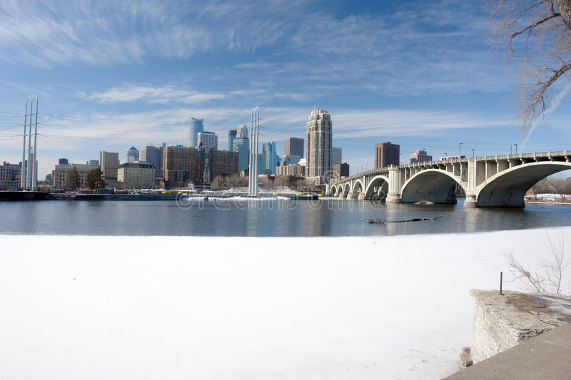 Urban Minneapolis across Mississippi river. A picture of Minneapolis cityscape across frozen Mississippi river royalty free stock image