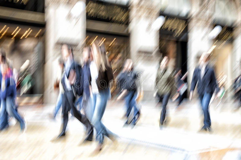 Urban move, people walking in city, motion blur, zoom effect. People walking in city, motion blur, zoom effect stock photo