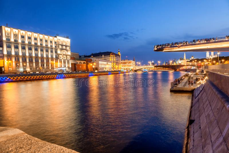 Urban night background, Moscow, the capital of Russia. Embankment in the city center, view of the river and park Zaryadye royalty free stock image