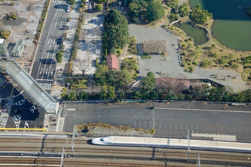 Urban park with the Shinkansen in Tokyo, Japan royalty free stock photo