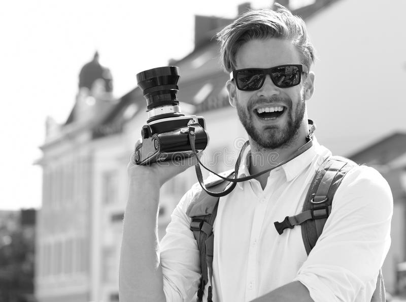 Urban photo and travelling concept. Tourist takes picture of cityscape. Young traveller or photographer royalty free stock photos